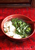 Soup with jiaozi and vegetables