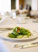 Green salad on elegantly laid table