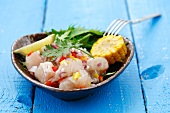 Ceviche with onion and chilli, corn and salad leaves, Peru