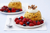 Dried fruit sponge dumpling with whipped cream and berries