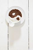 Yin yang symbol in sugar and chocolate in a coffee cup