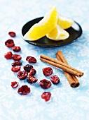 Cranberries, cinnamon sticks and orange wedges