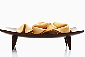 Fortune cookies on wooden platter