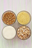 Grains of wheat, couscous, wheat flakes and semolina