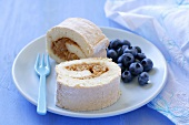 Sponge roll with apple filling and fresh blueberries