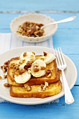 French toast with banana, maple syrup and walnuts