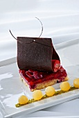 Raspberry slice with chocolate and garnish of pear balls