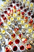 Many party desserts in glasses