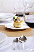 Vol-au-vent and red wine on laid table