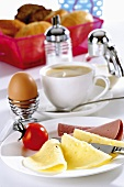 Breakfast: cheese, cold cuts, egg and coffee