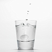 Glass of water with effervescent tablet
