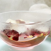 Rose petals in bowl of hot water