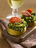 Slices of potato with kale and sausage