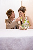 Young couple eating salad