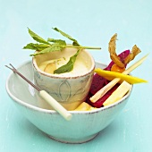 Exotic fruits and dip in a bowl, Close-up