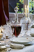 Festive place-setting with crystal glasses and red wine