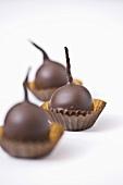 Three chocolate-dipped cherries