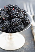 Blackberries in a silver stemmed bowl