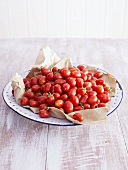 Plum tomatoes in a fruit bowl
