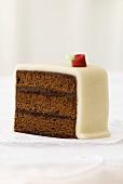 Piece of chocolate cake with marzipan coating