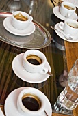 Several cups of espresso on table