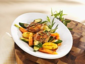 Noisettes of lamb with tarragon and vegetables