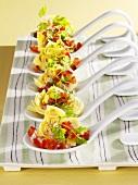 Artichoke hearts with tomato & chervil in mustard vinaigrette on spoons