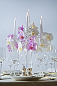 Candelabrum with orchids on table laid for special occasion