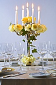 Candelabrum with yellow roses and ivy