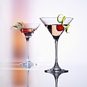 Raspberry Martinis with lime peel