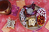 Appetiser platter: marinated quails' eggs, cherry tomatoes, stuffed radishes