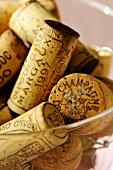 Champagne corks in glass (close-up)