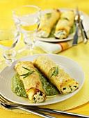 Lasagne rolls filled with ricotta on tarragon pesto