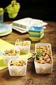 Nuts in plastic containers for a party