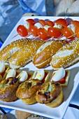 Pastries, boiled eggs, tomatoes & mozzarella on sticks (buffet)
