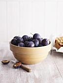 Fresh plums in bowl, plum cake beside it