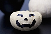 White pumpkin with face for Halloween