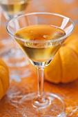 A glass of home-made pumpkin liqueur