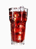 Glass of cranberry juice with ice cubes (with condensation)