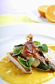 Chicken breast with mango sauce and basil