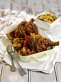 Braised lamb shanks with tomatoes and onions