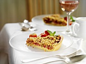 Piece of strawberry and rhubarb crumble tart