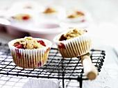 Raspberry and banana muffins on cake rack