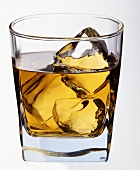 Whisky on the rocks in glass