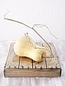 Butternut squash on wooden box