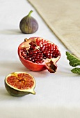 Half a pomegranate and fresh figs