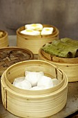 Assorted dim sum in bamboo steamers (Asia)