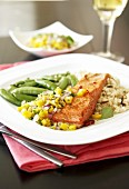 Grilled salmon fillet with mango salsa, green beans and rice