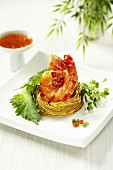Chilli prawn in noodle nest with shiso (Asia)