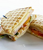 Toasted ham, cheese and tomato sandwiches